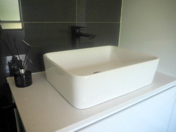 vanity with black taps