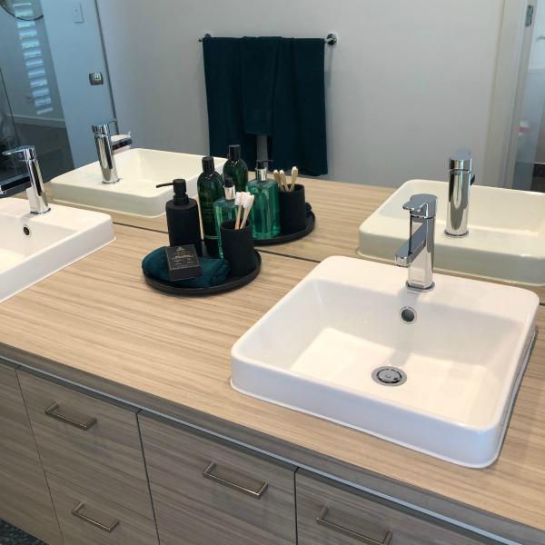 bathroom with a double vanity basin