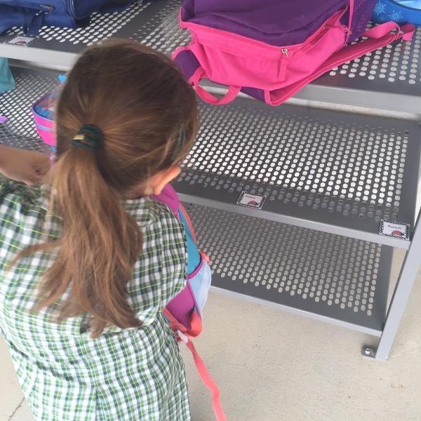esther placing bag on rack