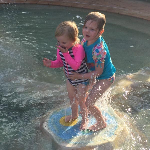 sisters in the pool