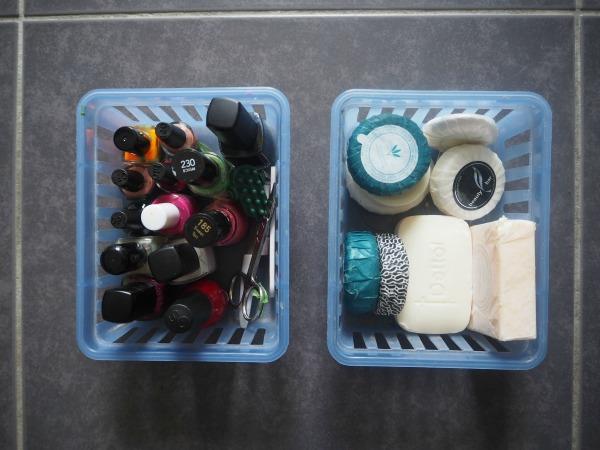 sort piles of products for decluttering bathroom vanity