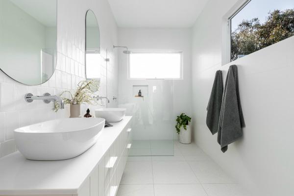 Modern coastal all white bathroom