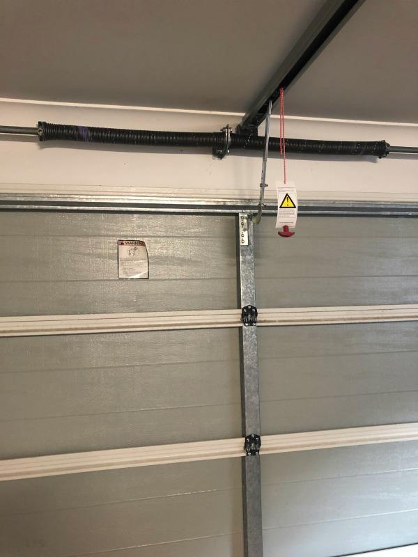 repaired broken spring on garage door