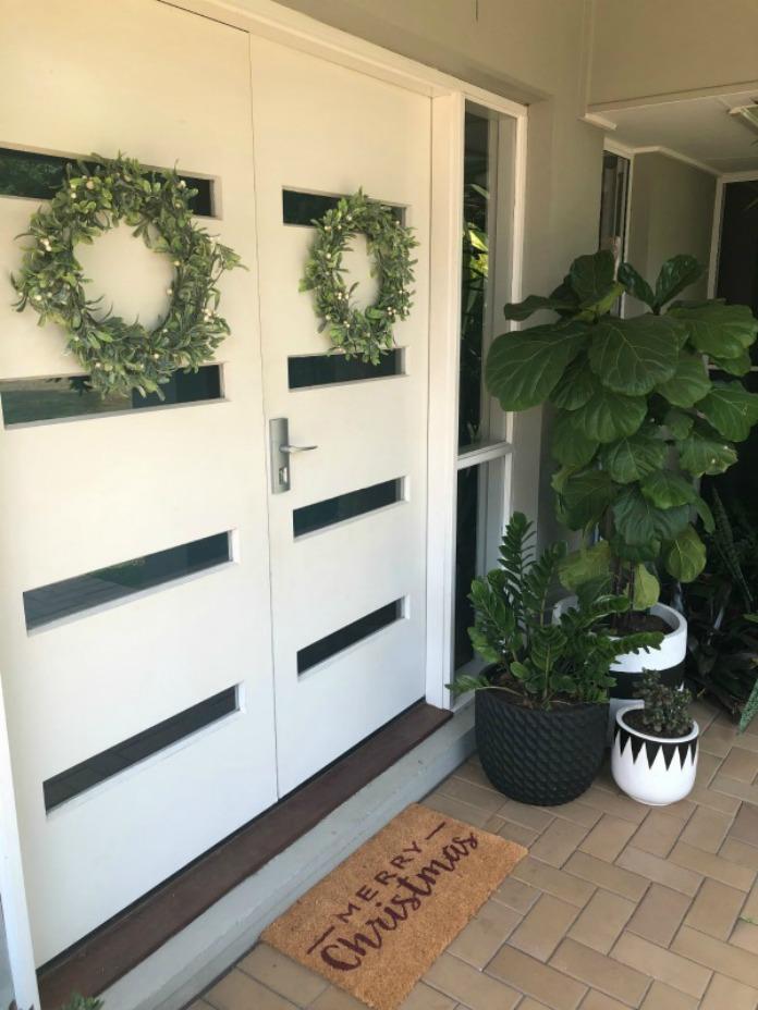 Hanging Christmas wreaths on double doors