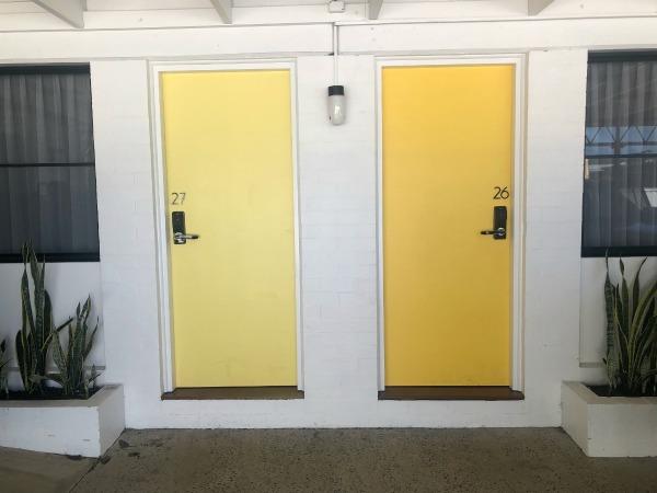 Yellow Motel Doors at The Cubana