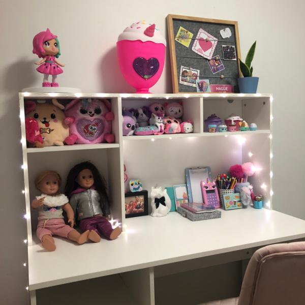 storage of stationery and toys on a kids desl